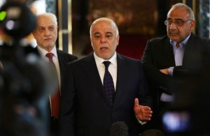 Iraqi Prime Minister Haider al-Abadi, center, holds a press conference before leaving to United States at Baghdad airport, Iraq, Monday, April 13, 2015. (AP Photo/Khalid Mohammed)