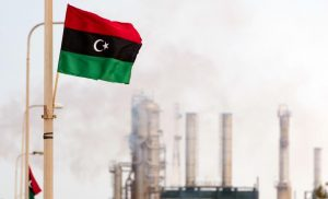 The new Libyan flag flutters outside an oil refinery in Zawiya on September 23, 2011. Total SA's Libyan joint-venture is set to restart oil production at its 40,000 barrels-a-day in Al-Jurf offshore field. Most of Libya's output of 1.7 million barrels a day was shut down after the revolution erupted in February. AFP PHOTO/Leon Neal (Photo credit should read LEON NEAL/AFP/Getty Images)