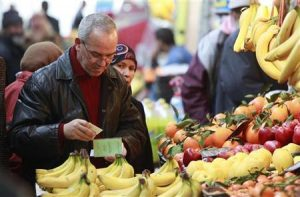 An Algerian man buys fruit at the Bab El Oued market in Algiers